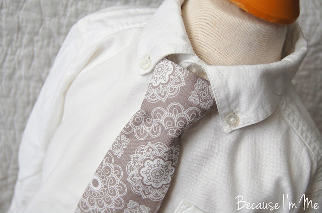 Because I'm Me silver gray medallion print necktie. Subtle simple sophistication.
