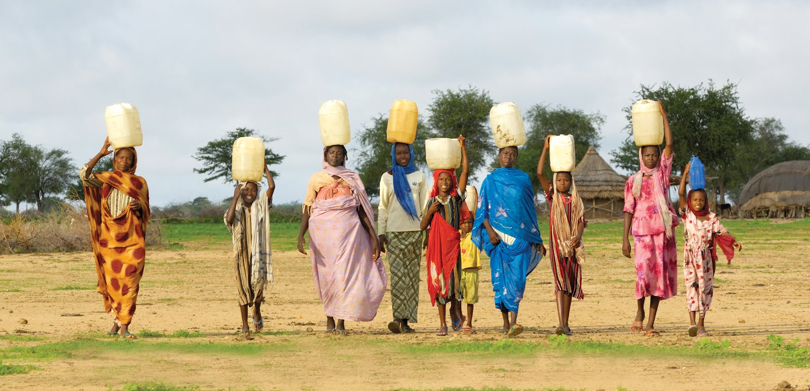 Women & Girls Carry Water Home in Darfur