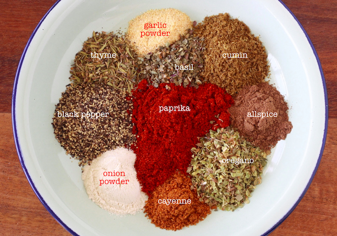 Homemade chili seasoning spices cumin, cayenne, paprika, black pepper, onion powder, garlic powder, thyme, basil, oregano, allspice