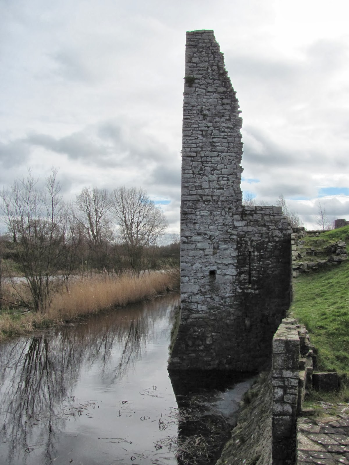 Part of a tower of the exterior wall stands along the moat of Trim Castle in Trim, Ireland