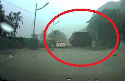 roca casi aplasta a conductor en taiwan china