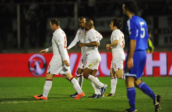 England player Ashley Young celebrates a goal against San Marino with teammate Jermain Defoe