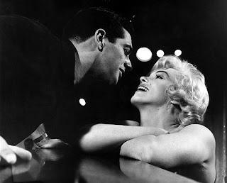 Marilyn Monroe con Rock Hudson en el rodaje de una película