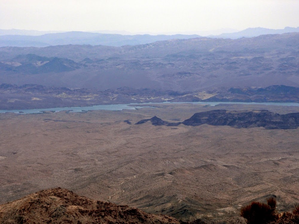 View below of Opal Mountain, Lake Mohave, the Black Mountains, the White Hills, the Cerbat Mountains