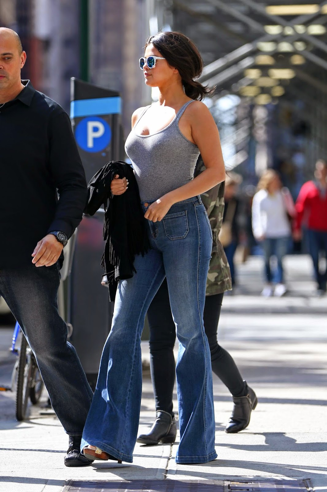 Selena Gomez bares cleavage in a tank top out and about in NYC
