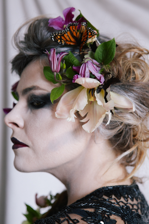 flowers and butterflies in hair.