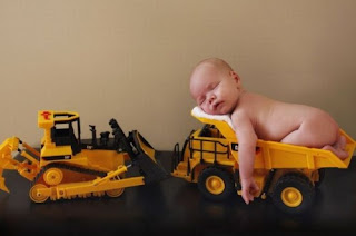 Funny picture: Baby sleeps on toys