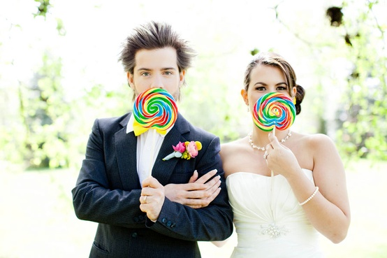 Candy in Weddings - Groom and Bride Holding Candy