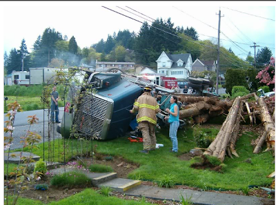 Logging truck accident tip over logs in yard Oregon