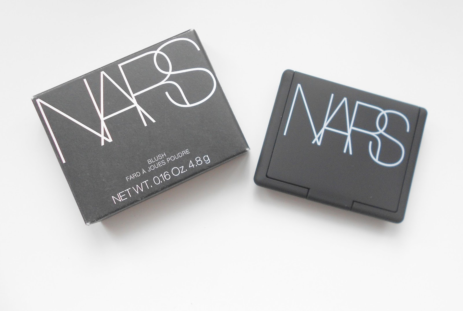 Nars torrid blush review swatches on cheeks