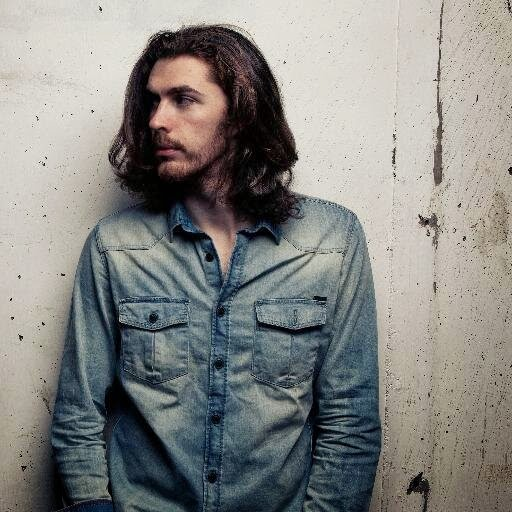 Image of Andrew Hozier-Byrne, or Hozier, looking off in the distance for a promotional photo.