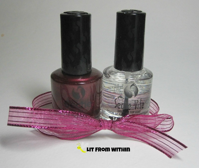I received a bottle of famous Seche Vite topcoat and Bella, a beautiful glowy blackened red