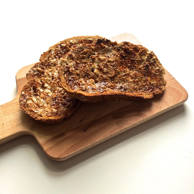 marmite on toast on a wooden board