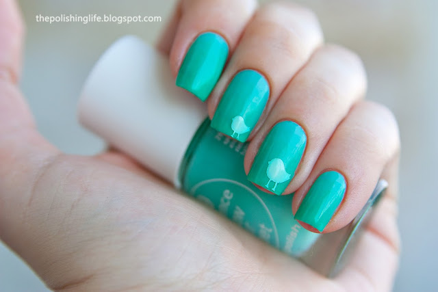 Essence Mint&Cream + China Glaze Keeping It Teal + Make It Stick bird decals.
