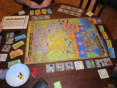 Power Grid - The board with a line of Oranjeboom beer mats marking the area of the board not in play