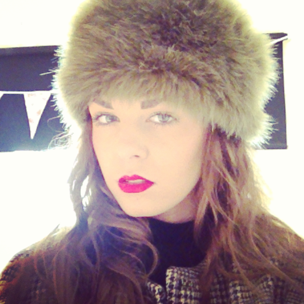 GIRL_WEARING_RED_MAC_LIPSTICK_AND_FUR_HAT