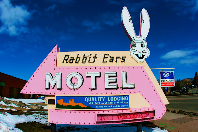 Blue sky behind the bright pink Rabbit Ears Motel sign in Steamboat Springs, Colorado.