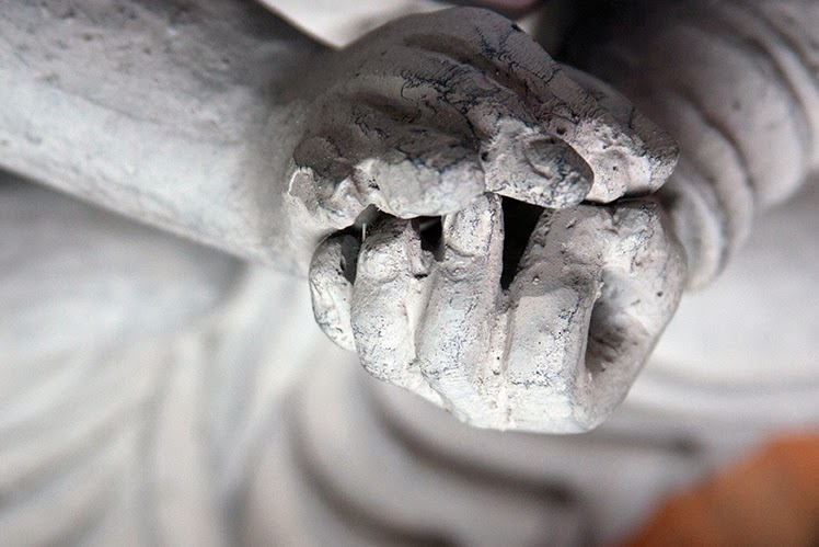hands of a grey buddha