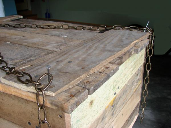 we put a giant lock where the chains cross and a bat plaque or coat of arms in the center of the coffin