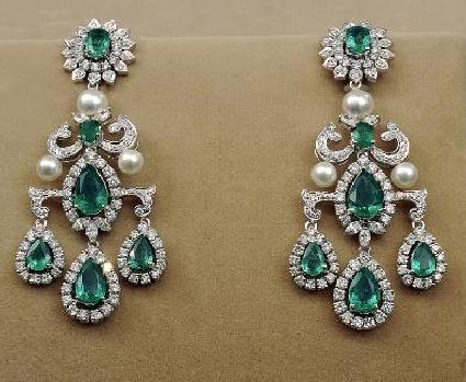 Checkout Tanishq gorgeous diamond emerald and south sea pearl
