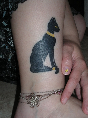 Black ink Cat Tattoo on Girls Leg
