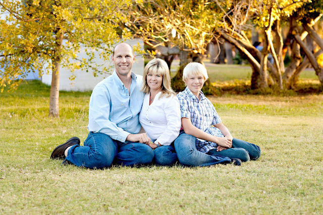 Family sits in grass at a favorite location of a Tucson photographer
