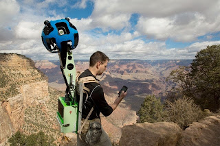 Google pic of a man with camera on his back in the Grand Canyon