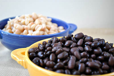 Cooked dry beans in colorful bowls