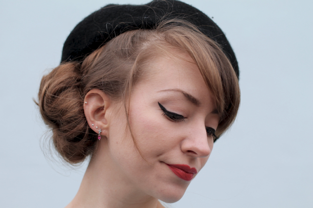 Beret with side bun hairstyle