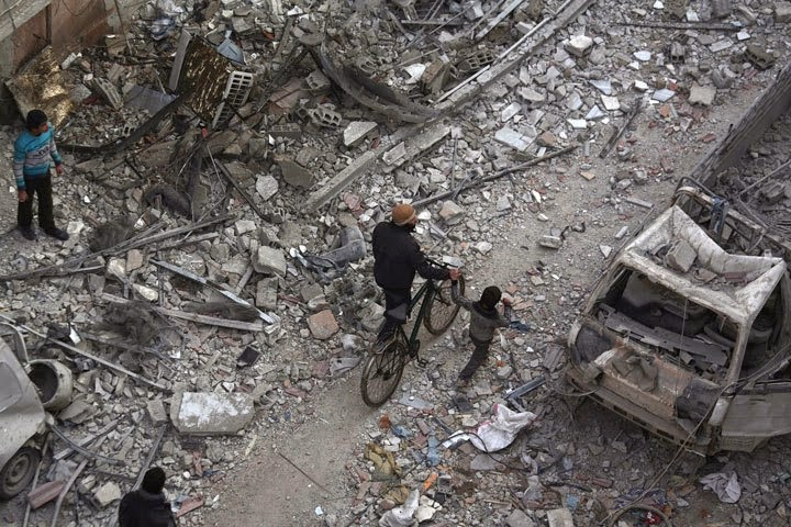 Syrian airstrike kills at least 35 near Damascus