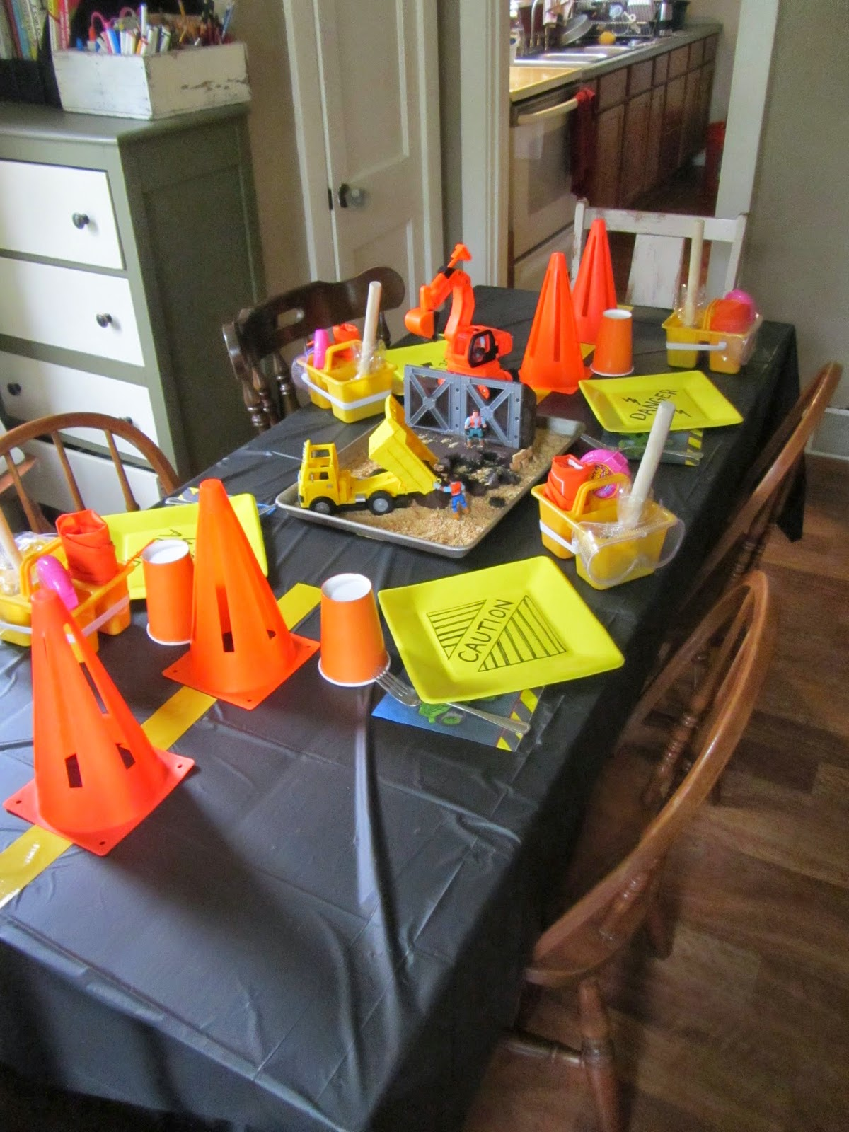 Construction Worker birthday party with several construction worker-themed games and decoration ideas {The Unlikely Homeschool}
