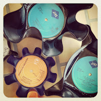 See the how to on making retro looking bowls from old records.