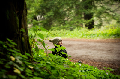 toddler sitting in the woods