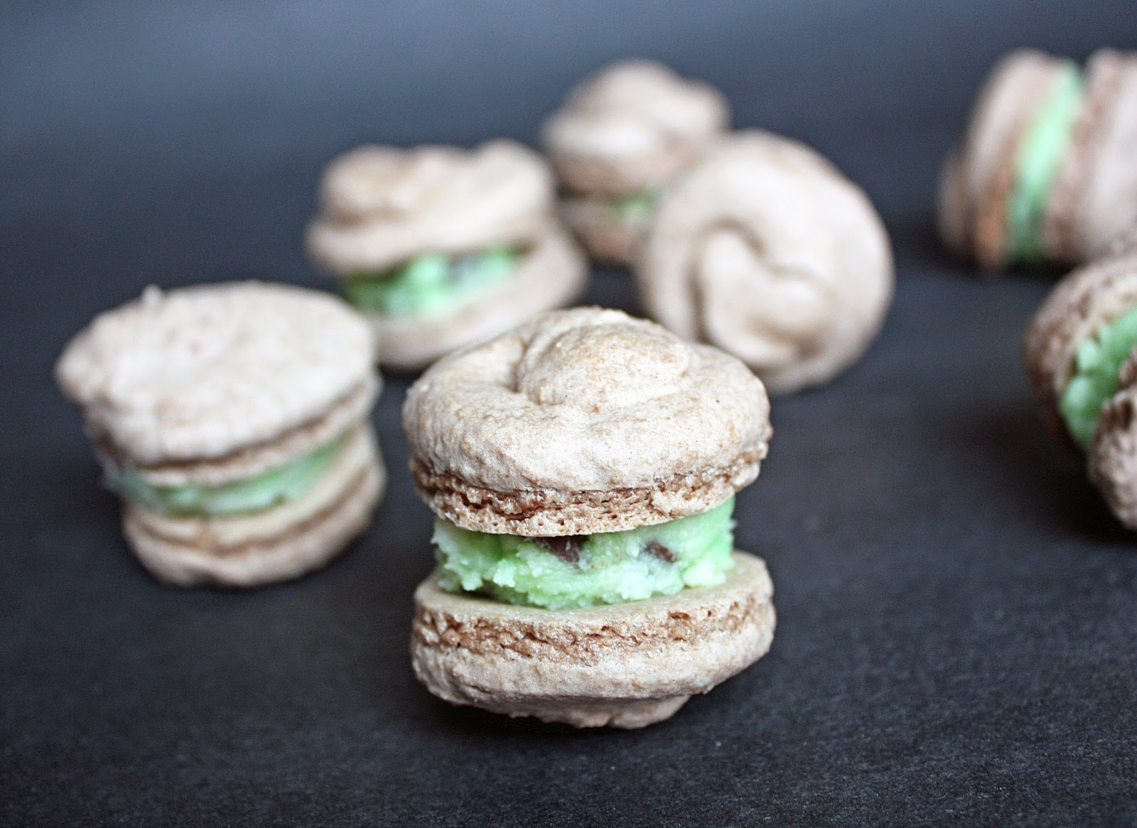 gluten-free vegan chocolate macarons with mint chocolate chip frosting