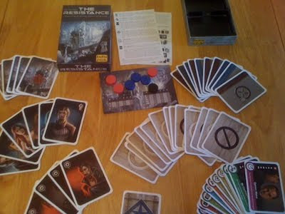 The Resistance card game components laid out before play