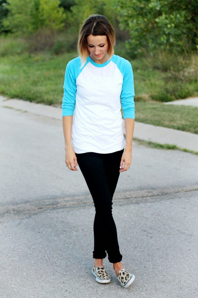 Aqua baseball tee, black denim and leopard sneakers