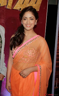 Yami Gautam Looks Gorgeous Beauty in Transparent Orange Saree and Shining Blouse