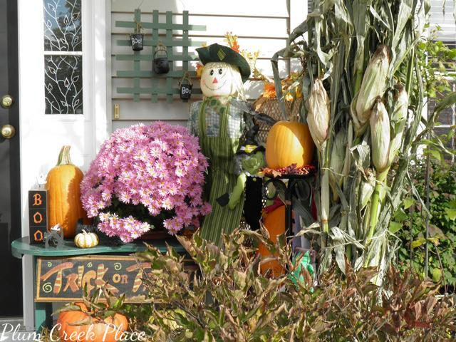 fall porch, cornstalks, pumpkins