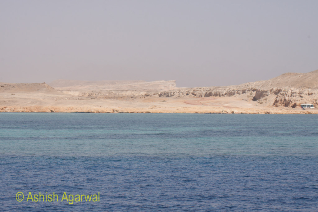 Rugged cliffs of the shoreline near the city of Sharm el Sheikh on the Red Sea