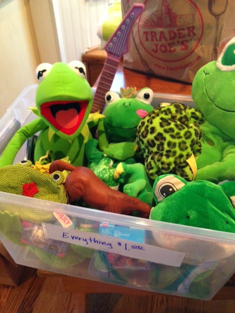 a bin of stuffed animal frogs