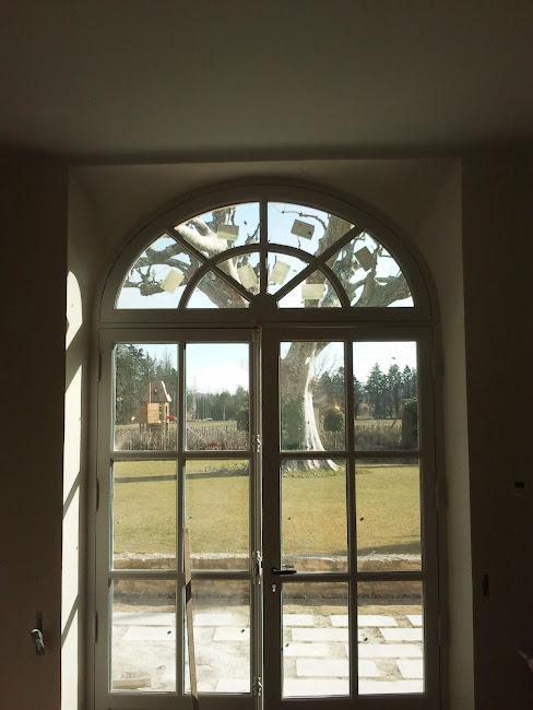 """Arrondi de fenêtre type """"aile de pigeon"""" avec structure en briquette"""