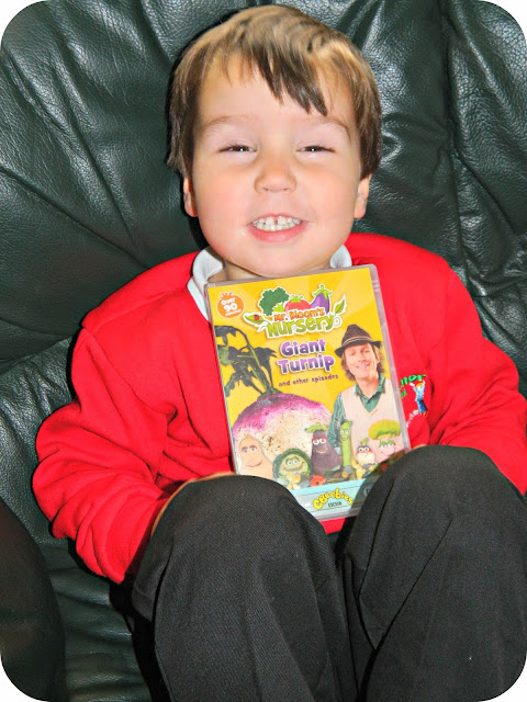 Small boy delighted with his Mr Bloom's Nursery Giant Turnip DVD cbeebies