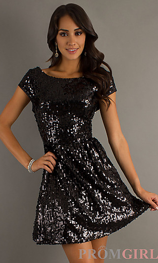 Fabulous retro cocktail dresses don't have an expiration date, dears! Elegant and classy with a flourish of deco, you'll find modern glamour in this gorgeous black flapper with sequined and beaded geometric squares covering the charming sheer mesh.