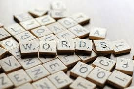 "photo of scrabble tiles spelling out the word ""words"""
