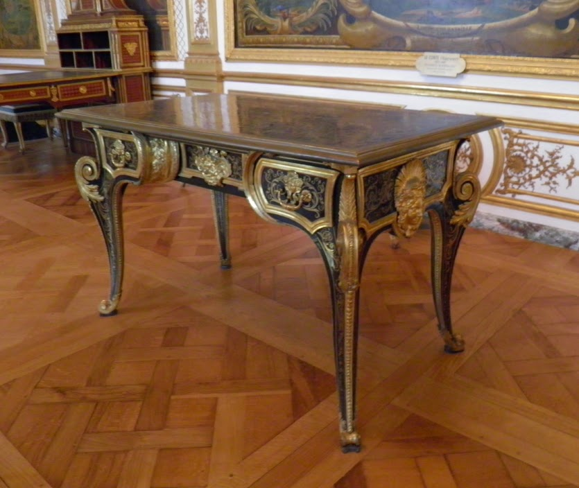 Bureau plat inlaid with brass and tortoiseshell, with characteristic gilt-bronze mounts (Musée Condé, Chantilly)
