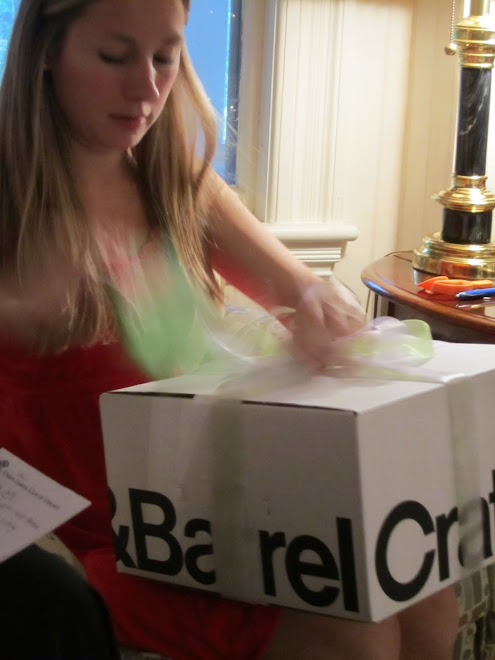 Caitlin opening her gift