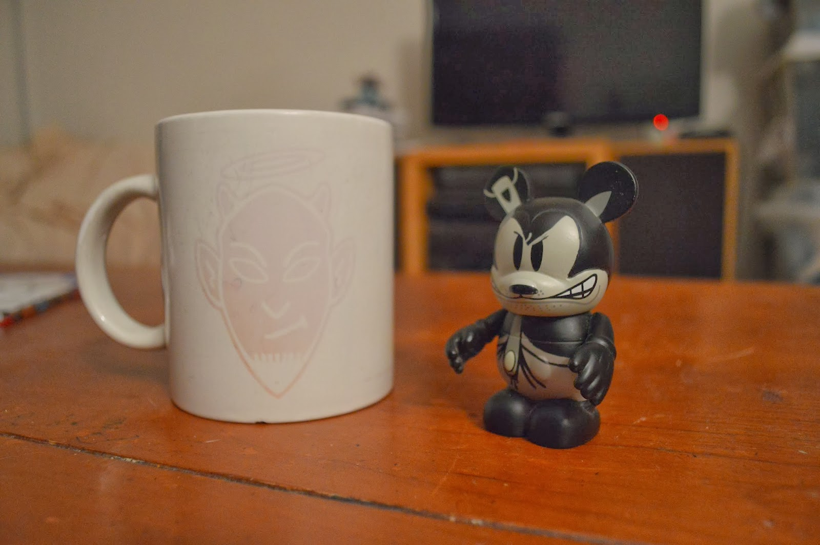 A photo of a cup and a figurine.