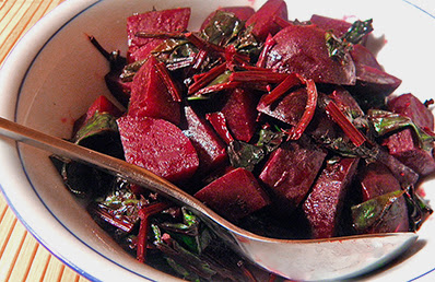 Serving Bowl of Balsamic Beets with Greens