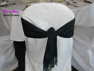 black scarf used as a chair sash