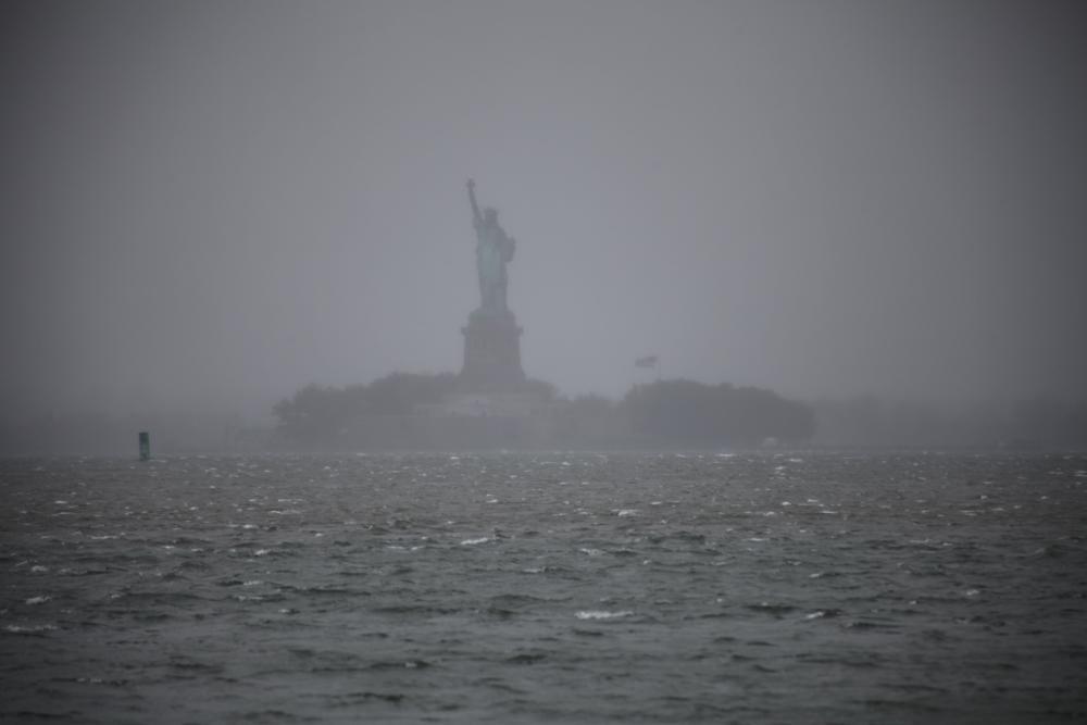 Hurricane sandy statue of liberty wave